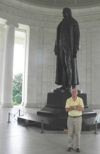 Jiles stands with a statue of Thomas Jefferson at the Jefferson Memorial in Washington D.C.