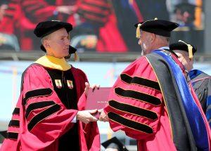 Muilenburg receiving diploma