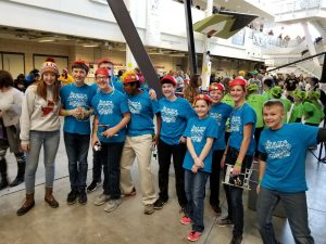 Fulcher <i>(far left)</i> volunteers and mentors students at FIRST Lego League. <i>Photo courtesy Fulcher.</i>