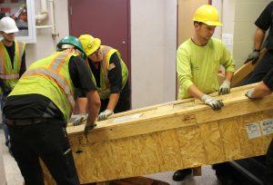 Crew members moving crate