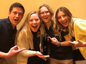 McLaren, Taylor, Gronewold, and Shah have some fun after winning their Student Chapter of the Year trophy. <i> Photos courtesy ISU MCA. </i>