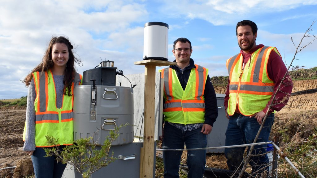 (From left) Schussler, co-principal investigator/ISU CCEE Assistant Professor Bora Cetin and Perez at a research site in Tama County, Iowa. <i>Photo courtesy Schussler.</i>