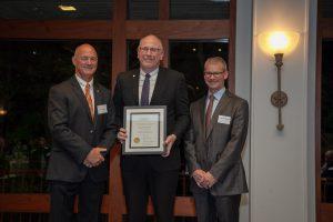 Sanders (middle) accepts his distinguished alumni honors. <i>Photo courtesy UT Austin</i>