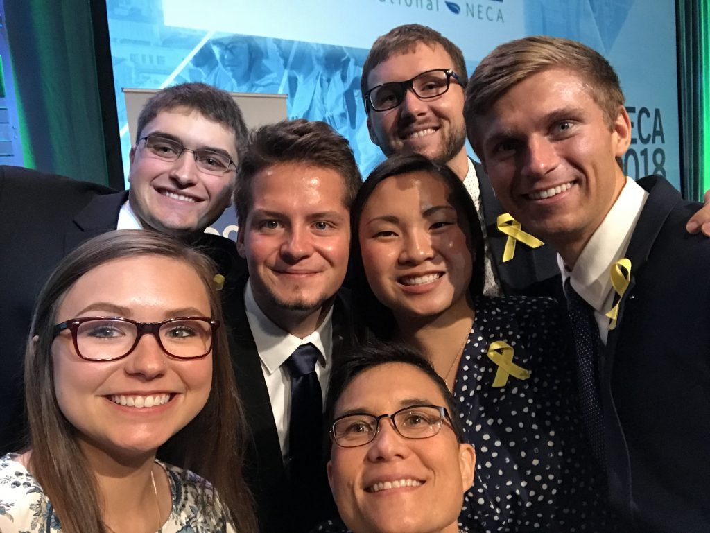 Team members from Cyclone Energy celebrate their win. The team wore yellow ribbons in remembrance of ISU CCEE student-athlete Celia Barquin Arozamena. <i> Photo courtesy Beth Hartmann.</i>