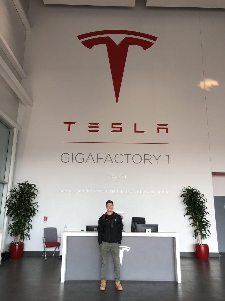 IE student Thomas Berquist poses in Tesla's Nevada office.