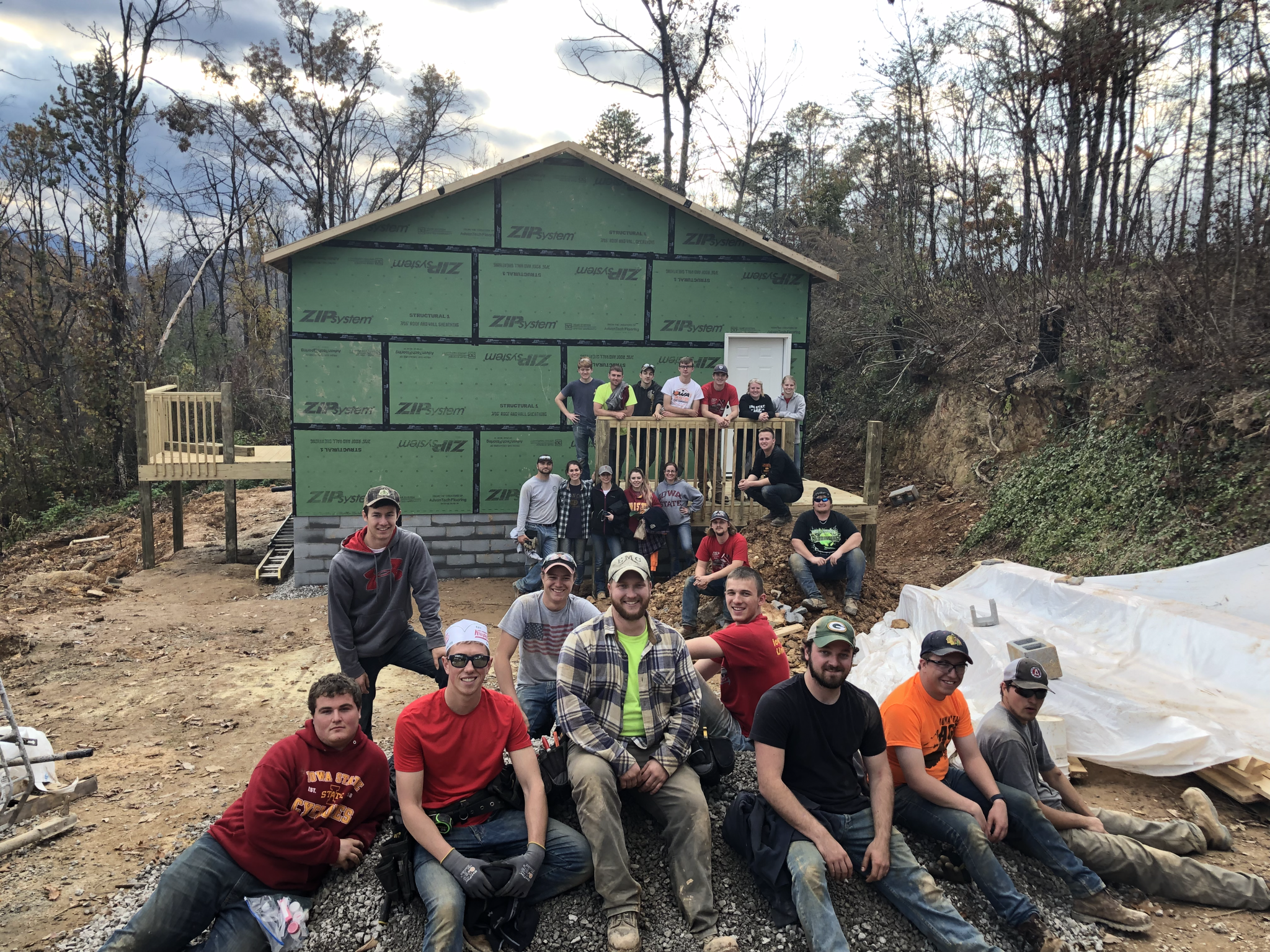 Members of Iowa State University's chapter of AGC gather outside one of their work sites during their fall 2018 volunteer trip. <i>Photo courtesy Nate Pals.</i>
