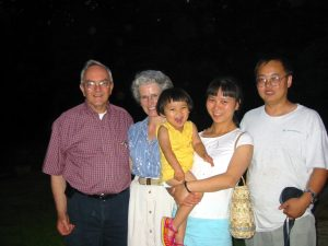Joan and Dr. Weber with Jie Long's family in Boone in 2003