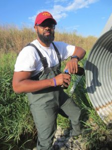Washington conducts field work while attending Iowa State in 2013. <i> Photos courtesy Washington.</i>