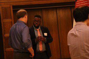 """Ravonte Campbell explains his research project titled: """"Onboarding newcomers: taking a look inside engineering onboarding processes"""""""