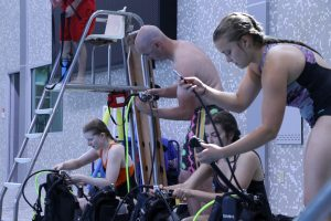 Participants get their first taste of astronaut training learning scuba basics at State Gym.