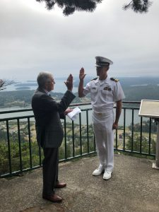 Spencer Stevens, left, reads the oath of office to his son-in-law, Matthew Letcher, right, at the ceremony in Anacortes, Washington in September.