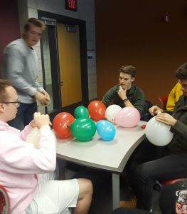 Students collaborating on balloon activity