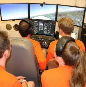 Students using flight simulator