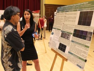Student showing research poster