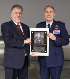 Vance and Arlene Coffman Endowed Department ChairAlric Rothmayer presents plaque to Maj. Gen. Crosier