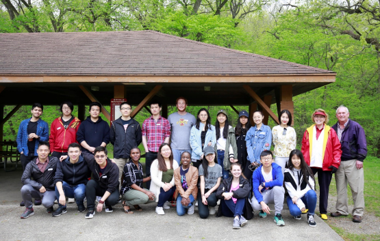 A group shot of mentoring program participants at a park shelter.