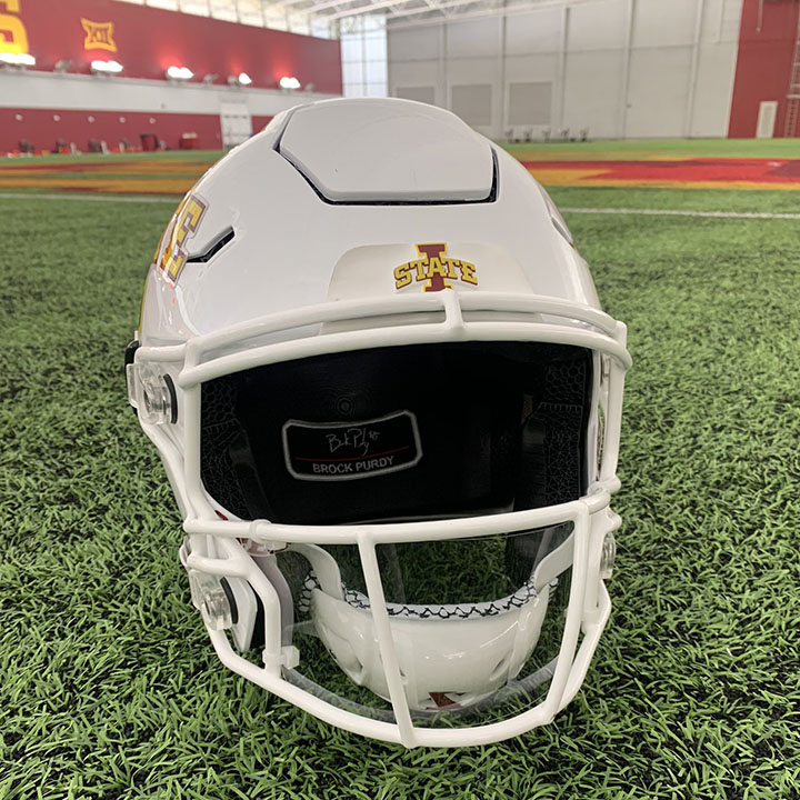 White football helmet marked with I-State sits on green grass