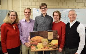 Former students poses with his classmate, instructor, and the president of Iowa State University. The group is displaying their business idea: Serona Craft Butter.
