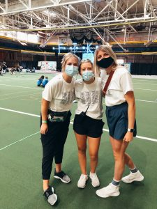 Three young ladies pose together inside of Lied Rec center on the Iowa State University campus.
