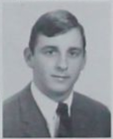 A black and white yearbook photo of Fred Dotzler wearing a suit and tie.