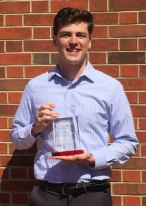 James Trettin with award plaque