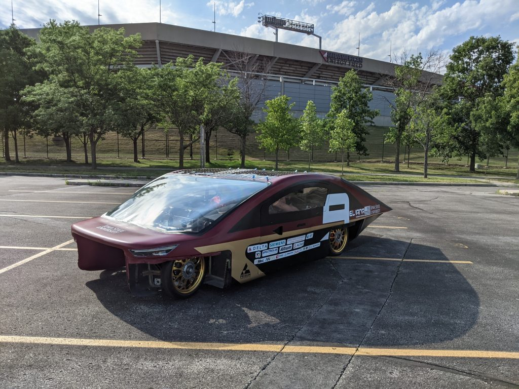 The solar car sits outside of Jack Trice Stadium.