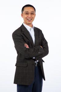 Photo of Hongwei Zhang standing and smiling