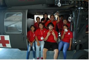 Cornelius and high school kids inside a helicopter