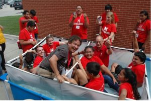 Cornelius with summer high school camp kids in a boat type device