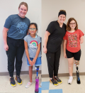 On left, Mechanical engineering student Jillian Dunn poses with Halle, a young lady from Alabama. Jillian is wearing a grey t-shirt and black pants, while Halle is wearing jean shorts and a grey t-shirt with a rainbow. On right, Mechanical engineering student Jillian Dunn poses with Serenity, a young lady from Ohio. Jillian is wearing all black, while Serenity is wearing black shorts and a red/orange t-shirt with a floral design.
