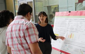 Maple Chen displays research poster