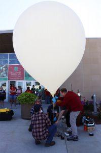 Matt Nelson and students adjust balloon