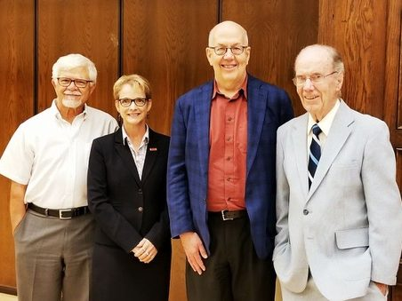 Four former department chairs of MSE stand together smiling for the picture