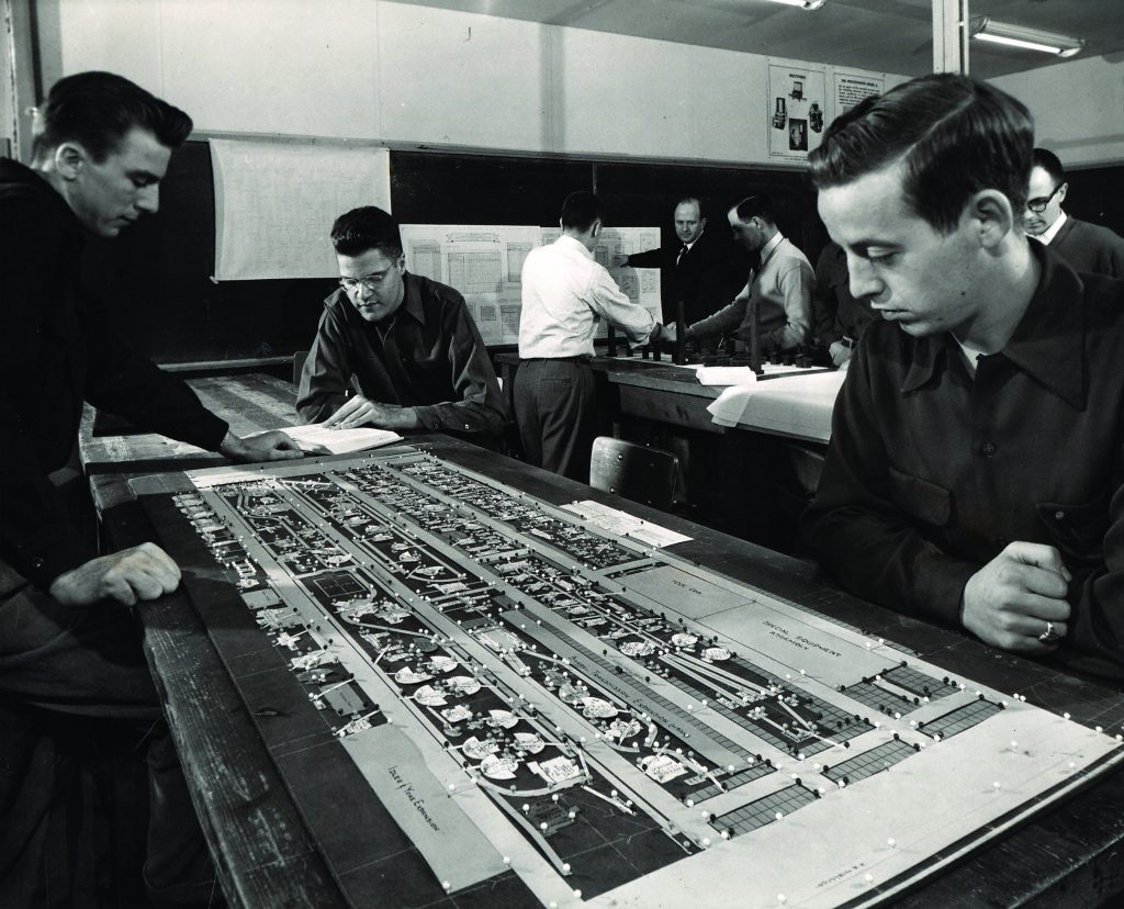 A black and white photo of an industrial engineering course from the 1950s.