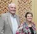 Turk and Joyce Therkildsen pose and smile inside Marston Hall.