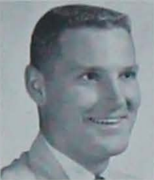 """A black and white senior photo of industrial engineering alum Charles George """"Turk"""" Therkildsen from the 1959 Iowa State University yearbook."""