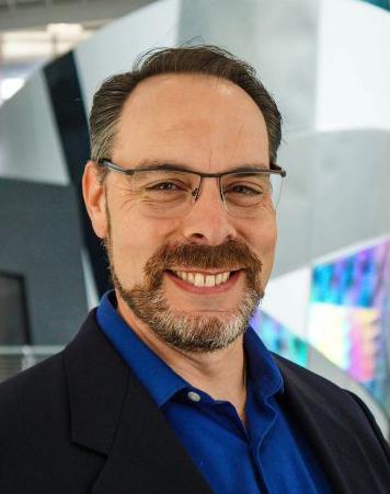 A headshot of mechanical engineering professor Eliot Winer.