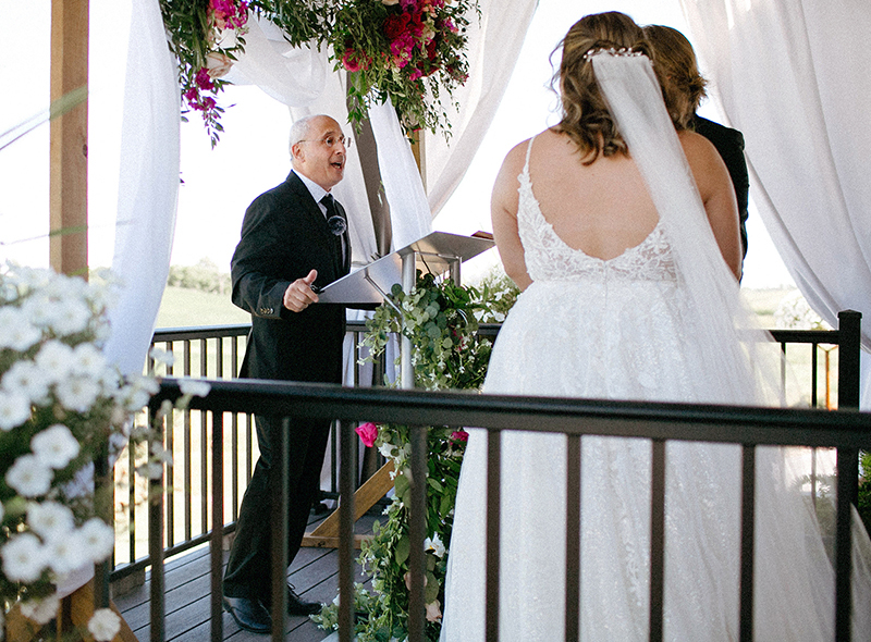 Teaching professor Alan Constant welcomes family and friends to the August wedding of high school sweethearts Jonathan Zaugg and Sara Medina.