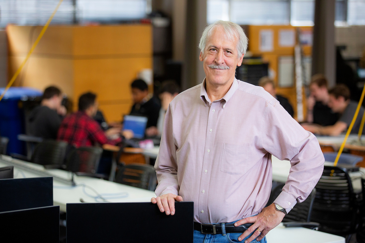 Doug Jacobson stands in a computer lab