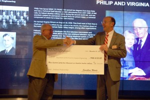 Jonathan Woods presents David C. Jiles with the check.