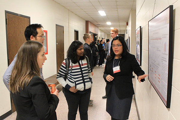 Civil engineering graduate students discuss research at the 3rd Annual Civil, Construction and Environmental Engineering Graduate Research Showcase and Poster Competition.